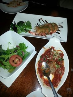 Appetizers: pancetta wrapped prawns, homemade meatballs and green salad with lemon vinegarette