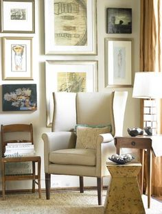modern wingback chair, gallery wall, and gold drapery.