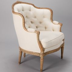 "19th Century Wide Bergere With Carved Wood Frame and Tufted Back  --  Circa 1860s French bergere has wide, generous proportions and decorative carved wood frame. Curved and tufted back, padded armrests and new upholstery. Arms are 25"" high, seat is 19"" high and 24"" deep.  --   Item:  6509  --  Retail Price:  $4295"