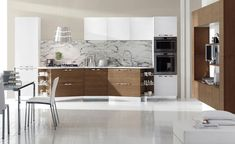 Medium Modern.  Medium Flat panel Cabinet. White counters White Tile Floor.