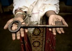 Holding Out The Giant Key To A Mansion In Kanadukathan, Chettinad, India by Eric Lafforgue, via Flickr