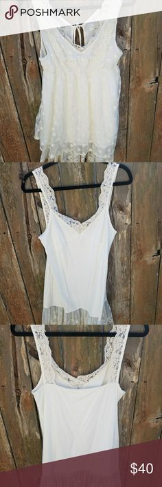 Hazel Flowy Cream Blouse Size L NWOT Hazel Flowy Cream Blouse. Size L.  Two separate top. Inside tank is 100% cotton with lace around top. Outer top is lace with poka dots.  NWOT Hazel Tops Blouses