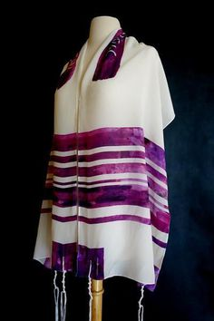 """Silk 'Lilach' Tallit From Advah Design  This tallit is named for Lilach, the stunning purple flowers whose sweet scentsignal the beginning of springtime. This tallit is made from100% silk crepe de chine, a wondefully soft and lightweight fabric that you'll love to drape around your shoulders. It measures18"""" x 70"""" andcomes with a handmade bag to store the tallit."""