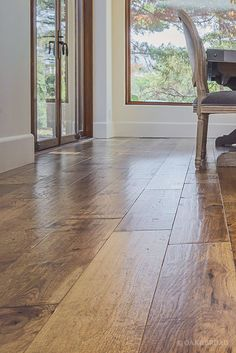 Wide Plank Hand Scraped Hickory Hardwood Floor By Oak And Broad | Light Reflecting Off Of Unique Hand Scraped Texture | Discover more at http://OakAndBroad.com/custom-hand-scraped-hickory-floor-cupertino/