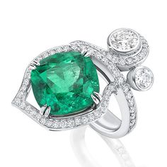 Boodles. Greenfire. An ethereal green fire burns within richly coloured emeralds, their luminosity symbolising a beam of light as it strikes through forest foliage. Petal shaped flames dance amongst swirling tendrils creating a natural harmony between the elements: earth and fire. Featuring the finest untreated Colombian Emeralds from the Muzo mines. View the piece in our Harrods boutique.