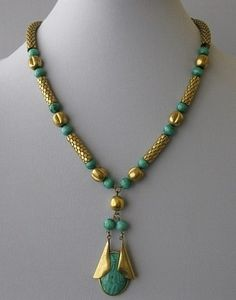 """Art Deco Egyptian Revival Necklace, brass, mesh like, tubular beads, slightly flexible; round, green glass bead intended to simulate malachite; 20.5"""" long with a pendant 2.75"""" drop; strung on brass chain, circa 1930s"""