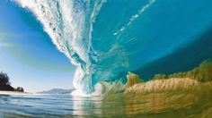 BIG BLUE- A large wave surges outward as it hits the shallow sand bank, sucking the sand off of the sea floor and into the wave itself, on the North Shore of Hawaii. (Photo: Clark Little)
