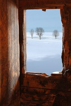 """""""Stable View"""" photo by Dave Gilbert, taken from inside a 19th-century stable along Route 7 in Wallingford, Vermont."""