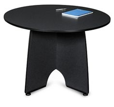 This modern round meeting table is perfect for small office spaces. #RoundTable #Furniture #ModernStyle