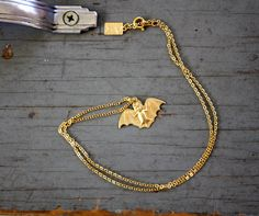 Little Bat  Brass pendant on a Gold plated Chain