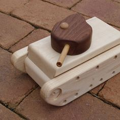 Handmade tank toy using only solid longboard scraps. This toy non-toxic and sealed with organic beeswax.