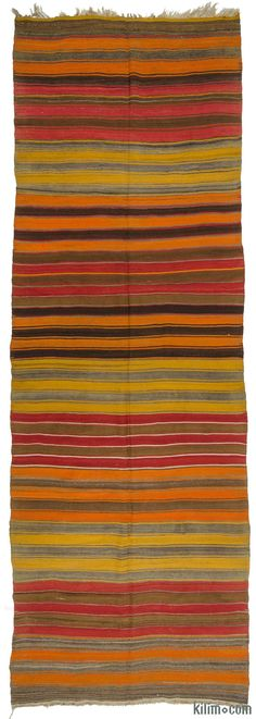 Vintage Turkish kilim rug around 50 years old and in very good condition. This banded kilim was hand-woven in the Konya region of Central Anatolia, Turkey.