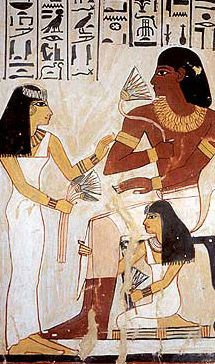 Meryt, the wife of Sennefer, presents him with lotus flowers - from a tomb