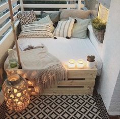 A good mix of cushions, throw, candles and an area rug can brighten up any balcony or reading nook you want to unwind in. black-and-white. #BW 45+ Fabulous ideas for spring decor on your balcony #outdoorgardens