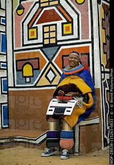 People Ndebele woman dressed in traditional costume of a married woman Traditional geometric wall paintings of Ndebele village in the background Lesedi Cultural Village near Johannesburg South Africa African Culture, African History, African Art, We Are The World, People Of The World, Les Seychelles, Motifs Textiles, Costumes Around The World, African Tribes
