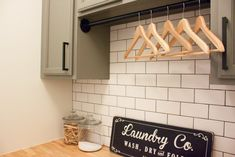 14 Small Laundry Room Ideas That'll Make You Swoon – Laundry Room İdeas 2020 Tiny Laundry Rooms, Laundry Room Remodel, Farmhouse Laundry Room, Laundry Closet, Compact Laundry, Laundry Area, Laundry Cabinets, Glass Storage Jars, Hanging Bar