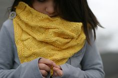 Scarf with a simple knit and purl combination and buttons
