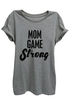 """""""Mom Game Strong"""" is featured on a crew neck, short sleeves and a new modern, relaxed fit for effortless style. Printed on quality constructed material, these shirts are perfect with a pair of jeans or shorts.FEATURES: Super Soft Blend: 52% combed and ring-spun cotton/48% polyester Relaxed Fitting Printed in USACARE: Machine wash cold separateSIZE + FIT: Model shown wearing Size M in Relaxed FitPlease refer to measurements in our size guide View Size Guide"""