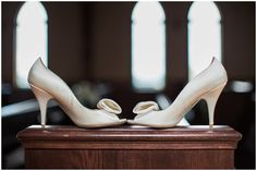 brides wedding shoes on end of pew in chapel at the whitestone inn