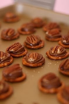 My family and I make these every year for Christmas. they are so delish!! pretzels, rolos, and walnuts.