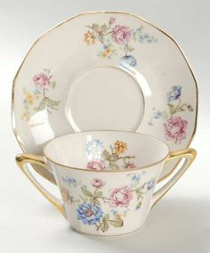 """""""Rosario"""" china pattern featuring gold trim with blue & pink flowers from Chas Field Haviland."""