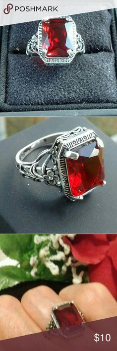 Vintage Ruby cz Sterling silver Ring 925 Ruby ring. That is etched on both sides with small flowers which make an intricate design. Must see to appreciate. NWOT.b Jewelry Rings