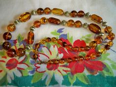 Vintage 1960s Amber Swirl Lucite Goldtone Beaded  Necklace 32 inches long by BlackRain4, $34.99