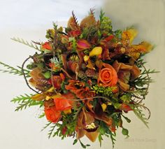 The texture in this bridal bouquet is amazing. Totally captures the feel of Autumn. Created by Dahlia Floral Design.