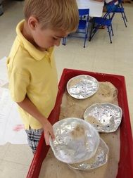 panning for gold during Wild  West week at Summer Camp