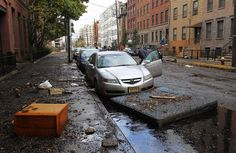 31)  A man checks his car as oil-filled floodwaters continue to fill streets in Hoboken, New Jersey, on October 31, 2012. (Reuters/Gary Hershorn)