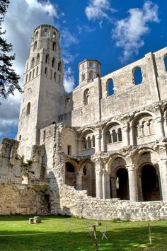 Among the atmospheric white stone ruins of the seventh century Benedictine seventh century Jumièges Abbey in Normandy, France.