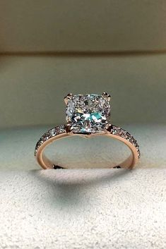 18 Rose Gold Engagement Rings By Famous Jewelers � rose gold engagement rings princess cut center diamond � More on the blog: https://ohsoperfectproposal.com/rose-gold-engagement-rings/ #RoseGoldJewellery