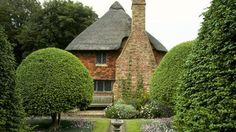 Alfriston Clergy House - laid out in the 1920s by the then tenant Sir Robert Witt to evoke a medieval garden, with old-fashioned roses, topiary, a potager for vegetables, a herb garden and an orchard. | Visitor information - National Trust