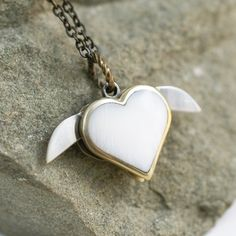 Tiny Secret Heart Double Knife Necklace at shanalogic.com #heart #knife