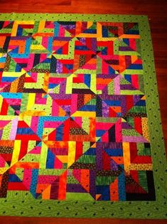 "Twisted Strips Quilt by ""Sandygirl"" from the quiltingboard.com"