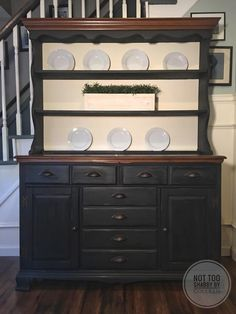 Refinished hutch, painted in black and old white chalk paint by Not Too Shabby by Colleen. Some of the original wood was left alone in order to add to the farmhouse look.
