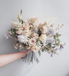 Bouquets: The style of this bouquet is lovely. I think the blush colour is nice and would go well with more blues/greenery