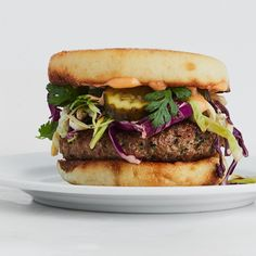 These Southeast Asian dumpling filling–inspired pork burgers will become your new go-to favorite weeknight meal. The sweet and spicy mayo acts as both a dressing for the slaw and the sauce for the burger. Slaw Recipes, Burger Recipes, Pork Recipes, Cooking Recipes, Slider Recipes, Diabetic Recipes, Yummy Recipes, Free Recipes, Hamburgers