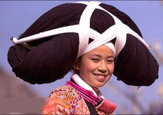 "The traditional dress of the Long-horn Miao of southern China includes a headdress made with a wooden core or ""horn"" wrapped in the hair of their ancestors, supplemented by woolen yarn. #China #TraditionalDress #hair"