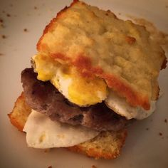 """Sausage & Egg Biscuits """"Low Carb Biscuits"""" INGREDIENTS: 1 1/2 cups almond flour 1/4 tsp salt 2 tbsp baking powder 2 eggs 1/3 cup sour cream 4 tbsp melted unsalted butter INSTRUCTIONS: 1. Preheat oven to 400 degrees. 2. Spray a muffin pan with non-stick cooking spray. I have a square one that's why mine looks like that. (These spread out too much and puff up very little on a cookie sheet.) Use a pan with 12 wells. 3. Mix all dry ingredients. Add wet ingredients and combine thoroughly. 4. Drop…"""