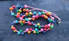 Rainbow wooden necklace on pale pink cotton cord Wooden Necklace, Organza Gift Bags, Handmade Jewellery, Wooden Beads, Pale Pink, Cord, Chokers, Jewelry Making, Beaded Bracelets