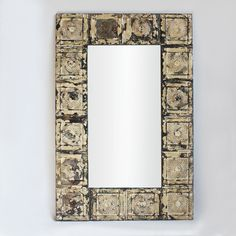 Original tin ceiling tiles repurposed into one of a kind large mirror frames.  Beautiful patina and texture.