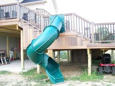 This is a Horizon Composite Deck but the real fun is the slide! By Heritage Deck Design & Construction in Sayreville, NJ.