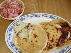 One of El Salvador's notable dishes is the delicious pupusas, thick corn tortillas stuffed with cheese, beans and pork.
