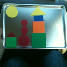 Travel trays! Cheap cookie sheets can be used to eat on, a hard surface for color pages, or (my favorite) magnets. I bought some sheets of foam, cut out shapes, & added magnets. Great for road trips!