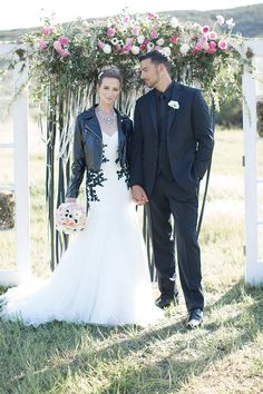 Leather and lace wedding photo shoot Bride black lace detail strapless gown with tulle skirt crystal statement necklace wearing black leather jacket