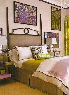 purple and green bedroom with a great headboard, interesting art and perfect decorative accessories