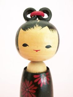 Cute kokeshi doll with black obi