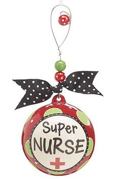 """Super Nurse Decorative Ornament. This larger than life jumbo size Christmas ornament is a fun way to show that talented nurse how much they matter! The hand painted ceramic ornament has a slightly raised design and features a beautiful hanger that is embellished with beads as well as a grosgrain ribbon. A stunning ornament of this caliber will make any nurse feel truly special! Comes in pre-packaged matching gift box. Size 8.25"""" x 4"""" x 4"""" with a 4"""" diameter."""