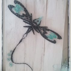 dragonfly string art all strung up